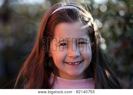 Portrait Of Pretty Girl With Brown Hair And Happy Expression
