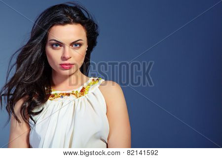 Beautiful young woman in white summer dress