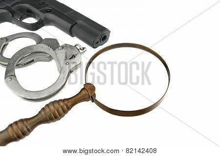 Gun, Handcuffs and Magnifying Glass