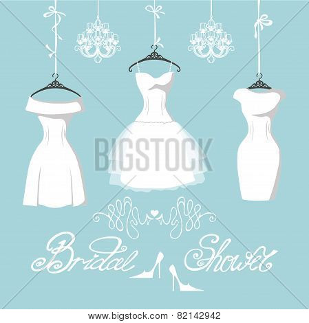 Set of  three bridal dresses hang on ribbons