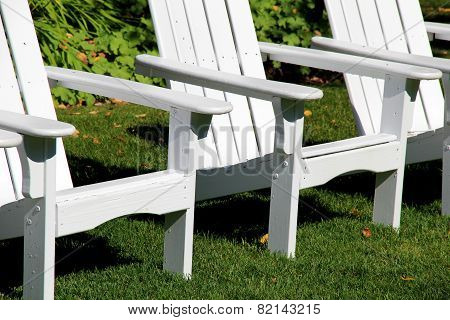 Arrangement of white adirondack chairs