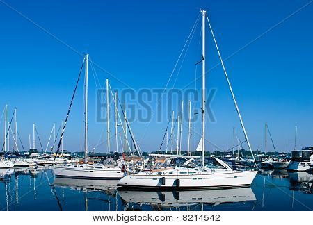 Luxury White Yachts And Boats Moored In Harbour