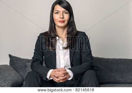 Businesswoman Sitting Looking At The Camera