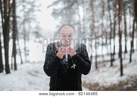 Groom Blowing Snow Off His Hands