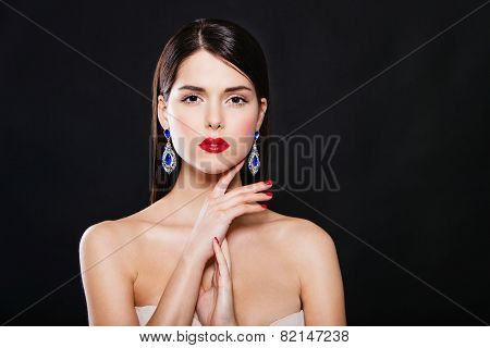 beautiful fashion model with perfect makeup wearing earrings