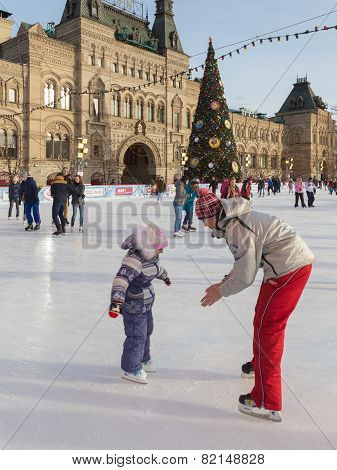Man Teaches A Child Skating