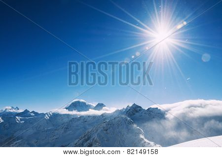 Winter Snow Covered Mountains At Sunny Day