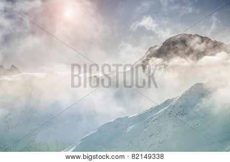 Winter Mountain Peaks At Sunset
