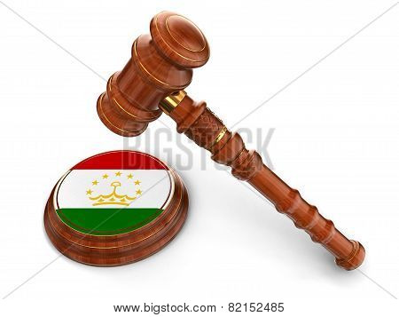 Wooden Mallet and Tajik flag (clipping path included)