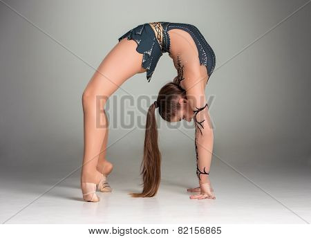 teenager doing gymnastics exercises