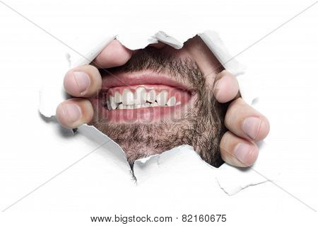 Man Looking Through Ripped Paper Hole