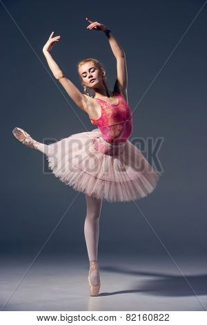 Portrait of the ballerina in ballet pose