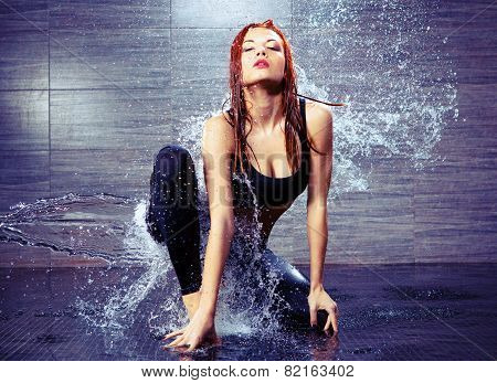 Beautiful woman in water studio