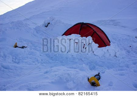 Tent in the snow in the mountains.