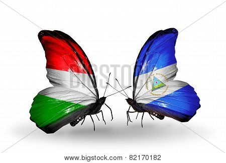 Two Butterflies With Flags On Wings As Symbol Of Relations Hungary And Nicaragua