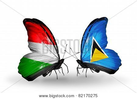 Two Butterflies With Flags On Wings As Symbol Of Relations Hungary And Saint Lucia