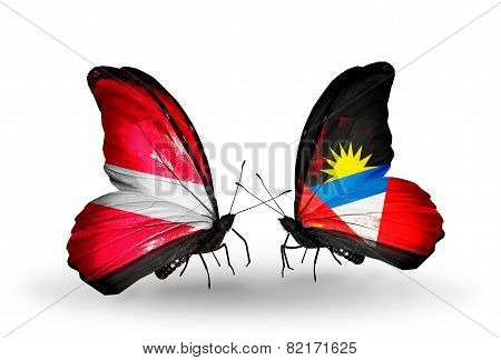 Two Butterflies With Flags On Wings As Symbol Of Relations Latvia And Antigua And Barbuda