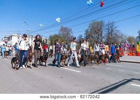 Cynologists from club of dog breeding on parade