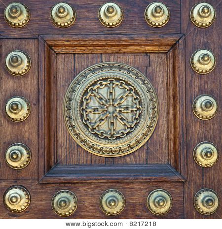 Gold Studs And Symbol On Wooden Door