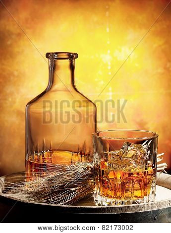 Glass Of Whiskey Decanter And Ears Of Wheat