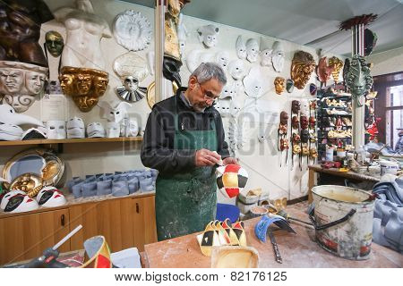 Man Making Carnival Mask