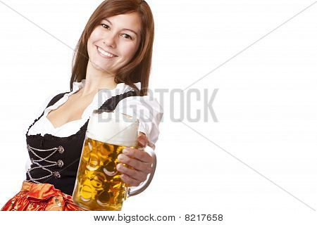 Happy smiling woman in dirndl dress holding Oktoberfest beer stein.