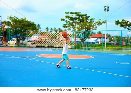 Young Boy Throwing Ball, Playing Basketball On Playground