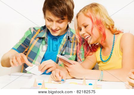 Boy and girl playing table game at home