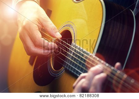Man playing an acoustic guitar