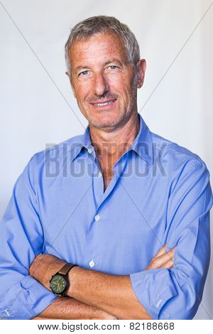 portrait of a confident mature handsome man smiling