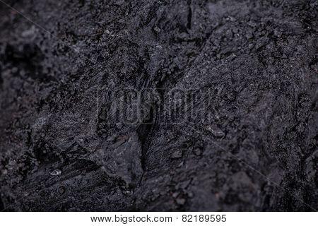 Coal lumps on dark background, close-up