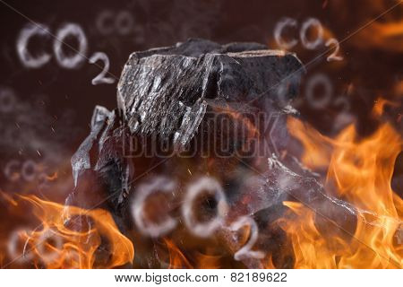 Coal lumps with fire flames on dark background