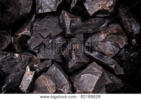 Coal lumps on dark background, close-up
