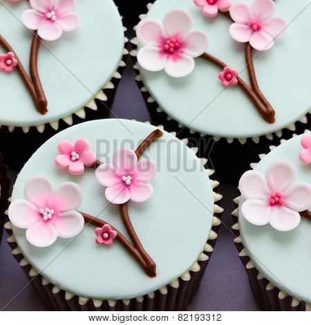 Cupcakes decorated with cherry blossom flowers