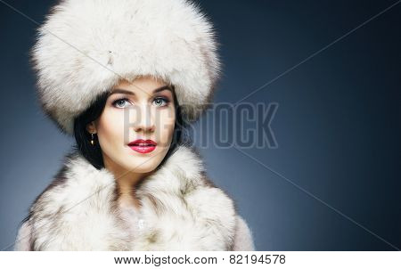 Fashion style portrait of a woman in an elegant winter fury clothes