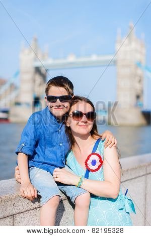 Portrait of a mother and son in front of Tower bridge in London at Bastille day celebration
