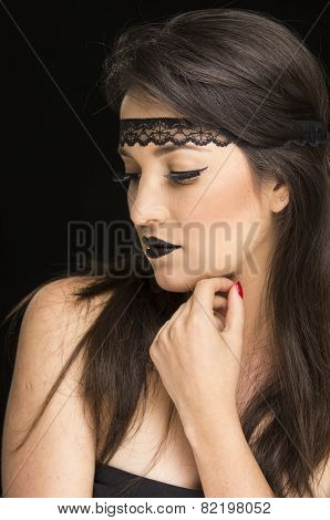 beautiful young woman wearing goth makeup