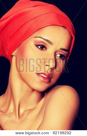 Attractive woman with make up and head in turban.