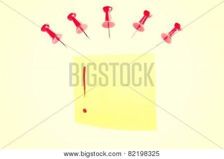 Red drawning pins with yellow memo.
