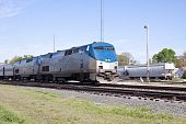 picture of amtrak  - Two locomotives on the front end of a passenger train - JPG