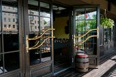 stock photo of posh  - Glazed entrance to the luxurious restaurant  - JPG