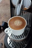 image of brew  - Cup of freshly brewed espresso from a capsule - JPG