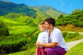 stock photo of cameron highland  - family enjoying view on tea plantation Cameron Highlands - JPG