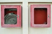 stock photo of not found  - The abandoned old fire hose cases found on the wall shown that not care has been taken of - JPG