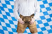stock photo of upper thigh  - Bavarian man with brown Oktoberfest leather pants  - JPG