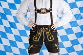 picture of upper thigh  - Bavarian man with black Oktoberfest leather pants  - JPG