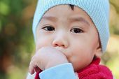 picture of snot  - Asian baby was sick and runny nose close up - JPG