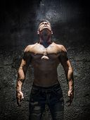 pic of shirtless  - Shirtless Muscle Man Looking Up Into Bright Overhead Light Illuminating Him Like a Superhero - JPG