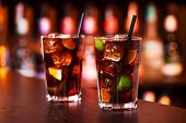 stock photo of oz  - Cuba libre is a famouse cuban cocktail. It is made of: