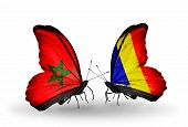 stock photo of chad  - Two butterflies with flags on wings as symbol of relations Morocco and Chad Romania - JPG